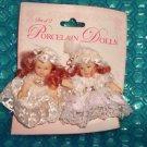 Porcelain Dolls & Mini Tea Set   stk#(2505)
