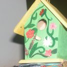 green/yellow flora birdhouse