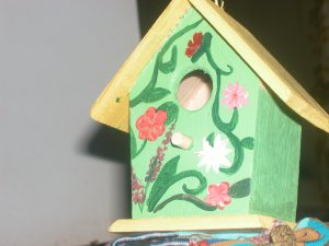 green/yellow flora birdhouse