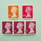 UK Royal Mail Stamps with profile of Queen Elizabeth II on them in 3 colors