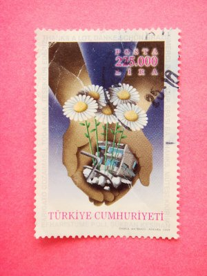 Postage Stamp with an open hand and international thank you message drawn on it