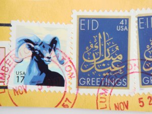 Partial Envelope with several United States Postage Stamps about Eid and Ink Postmark on it