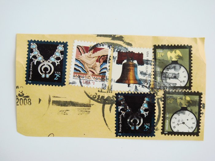 Partial Envelope with six United States Postage Stamps and Ink Postmark on it