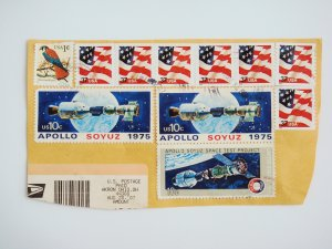 Partial Envelope with eleven United States Postage Stamps and Ink Postmark on it
