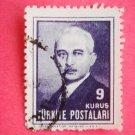 9 kurus Turkish Postage Stamp in blue with Ismet Inonu on it