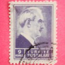 Turkish Postage Stamp 9 kurus in blue with Ismet Inonu from profile on it