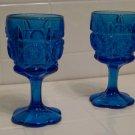 pair of heavy blue glass goblets. water glasses dinner glasses