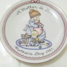 A mother is love mothers day 1987 plate by Avon