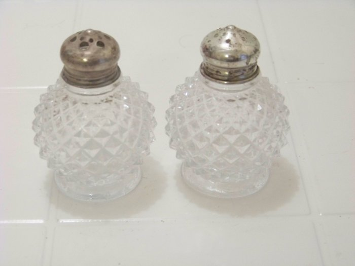 clear glass salt and pepper shakers with sterling silver tops