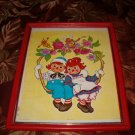 FRAMED PRINT OF RAGGEDY ANN & ANDY SWINGING ON A VINE