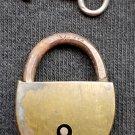 Small vintage padlock with key