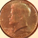 1976 Kennedy Halve Dollar. Raw. BU.