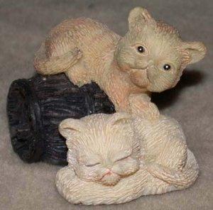 Kittens on a Barrel