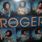 the maney facets of roger / wb23594