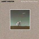 alone but never alone / mca 5689 larry carlton