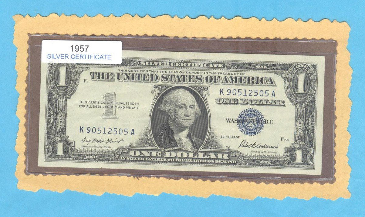 1957 = $1.00 = SILVER certificate