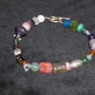 bracelet multi colored mixed materials beads and stones