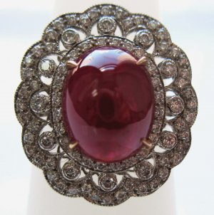 Cabouchon Ruby Ring with Unique Diamond Setting