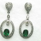 Elegant Diamond Earrings with Oval Emerald