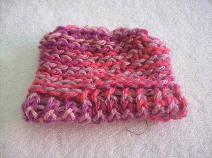 Hand-knitted doll hat, pink