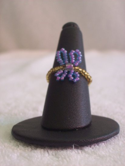 Butterfly ring, purple on gold