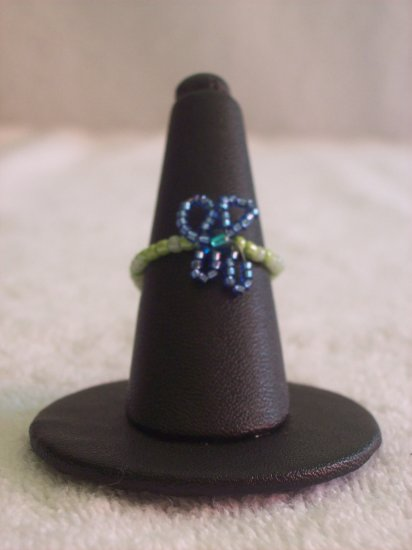 Butterfly ring, dark blue on various green