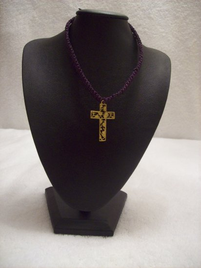 Gold floral cross on purple square
