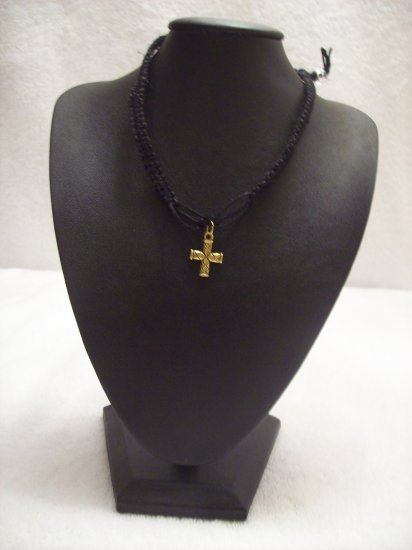 Gold cross on black square/open square