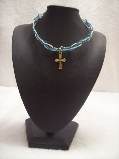 Gold cross on blue and turquoise square/switchback