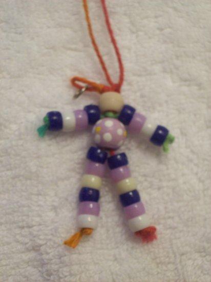 Flower bead (purple), tan, dark blue, purple, white