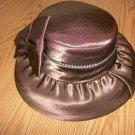 ladies Brown satiny feel cloth covered hat with stones