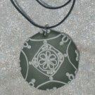 khaki and white pendant