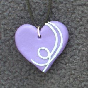 Purple heart pendant with blue detail