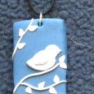 Bird on a blue background pendant