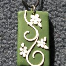 Green and white floral pendant