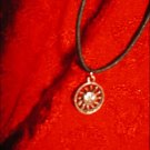 SILVER-TONED ENCIRCLED SUN W/ RAYS CHARM ON CORD