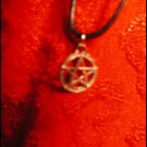 SILVER-TONED UPRIGHT PENTACLE CHARM ON CORD