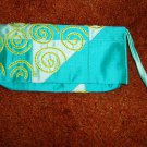 Turquoise shimmering handheld beaded bag made of cloth