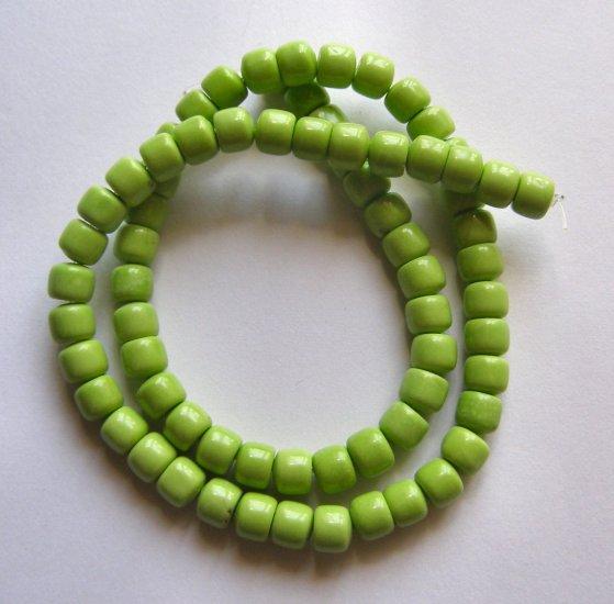 "Gaspeite Green Magnesite 7x6 Drum Beads 16"" strand"