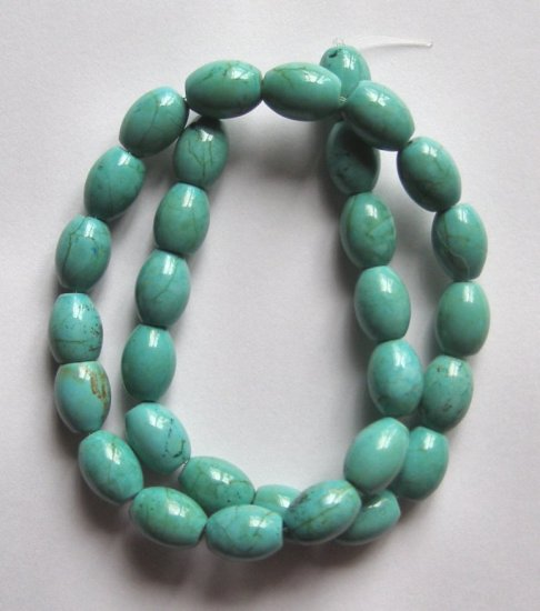 "Turquoise 14x10 Barrel Beads 16"" strand"