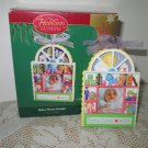 Baby Photo Holder 2004 Christmas ornament by Carlton Toys Movement