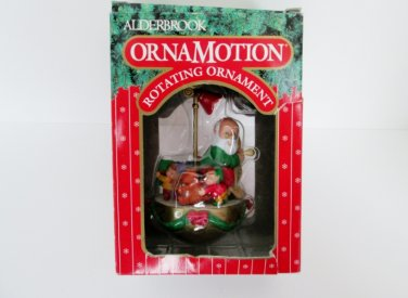 Noma Ornamotion Titled Santa's List Santa reading his Christmas List with Elves Rotating Ornament