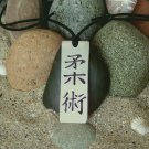 Jujitsu in Kanji , stainless steel pendant on natural leather cord. A surfer style necklace