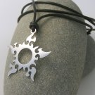 Sun Tribal stainless steel pendant on natural leather cord.               A surfer style necklace
