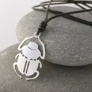 Scarab, stainless steel pendant on natural leather cord.    A surfer style necklace.