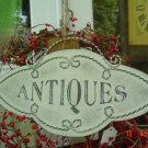 PRIMITIVE METAL ANTIQUES SIGN WITH JUTE HANGER
