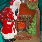 Ceramic Christmas Scene Lighted Silhoutte with Santa By The Fireplace
