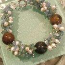 Multi gemstones and freshwater cultured white pearls in sterling sliver bracelet. 9''