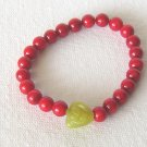 B00002  Handmade strecth beaded bracelet with elastic cord, dyed red coral & lemon jade flower