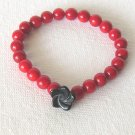B00003  Handmade strecth beaded bracelet with elastic cord,dyed red coral & obsidian flower